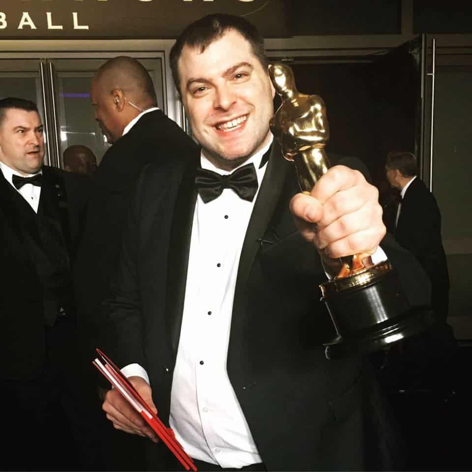 Andrew Carlberg Holding his Oscar